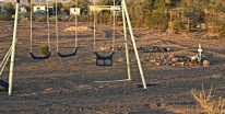 Play ground swing next to final resting place of?
